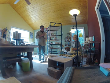 Scott and Debbie Williamson in the kiln shed and wood kiln studio